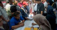 Family members of victims of the ill-fated Lion Air flight JT 610 submit papers and photographs of their lost relatives at a disaster victim identification unit at a police hospital in Jakarta on October 30.//AFP