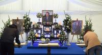 People sign a book of condolence set up outside Leicester City Football Club's King Power Stadium in Leicester, eastern England, on October 30, 2018. // AFP PHOTO