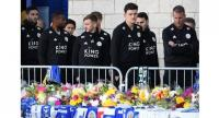 Leicester City players walk around the floral tributes left to the victims of the crash at the King Power Stadium.