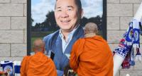 Buddhist monks lay tributes by a photograph of Leicester City Football Club's Thai chairman Vichai Srivaddhanaprabha, outside Leicester City Football Club's King Power Stadium in Leicester, eastern England, on October 31, 2018./AFP