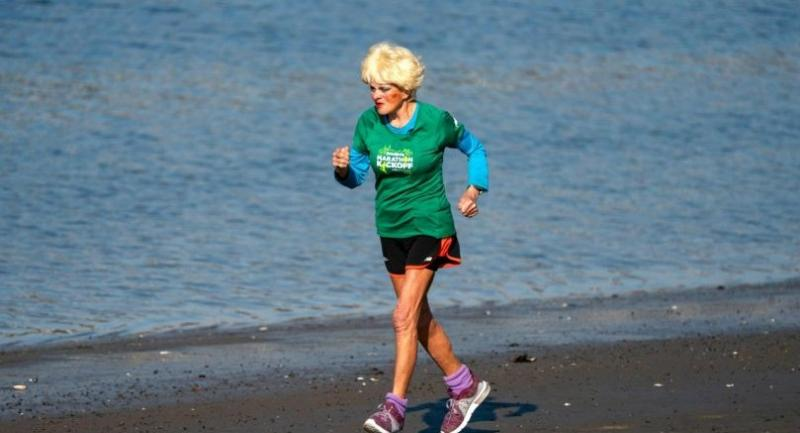 French marathoner Ginette Bedard, 85, runs near her home in the Queens Borough of New York on November 1, 2018. - Bedard plans to run in this year's NYC Marathon scheduled to take place November 4, 2018. (Photo by Don EMMERT / AFP)