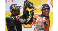 Repsol Honda Team Spanish rider Marc Marquez (R) celebrates on the podium with Monster Yamaha Tech 3 team French rider Johann Zarco after winning the Malaysia MotoGP at the Sepang International Circuit in Sepang on November 4, 2018.