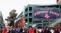 File photo : Fans gather outside Fenway Park after the Boston Red Sox Victory Parade on October 31, in Boston, Massachusetts.//AFP