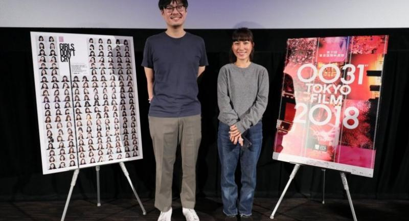 """Director Nawapol Thamrongrattanarit and producer Pacharin Surawatanapongs brought their latest documentary """"BNK48: Girls Don't Cry"""" to Japan, the home country of AKB48. The screening at the Tokyo International Film Festival was well attended."""