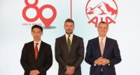 Tan Hak Lek, left, chief executive officer of AIA Thailand, with Stuart A Spencer, right, chief marketing officer of AIA Group, and David Beckham, centre, AIA Global Ambassador, seen on Saturday at AIA Thailand's 80th anniversary celebrations.