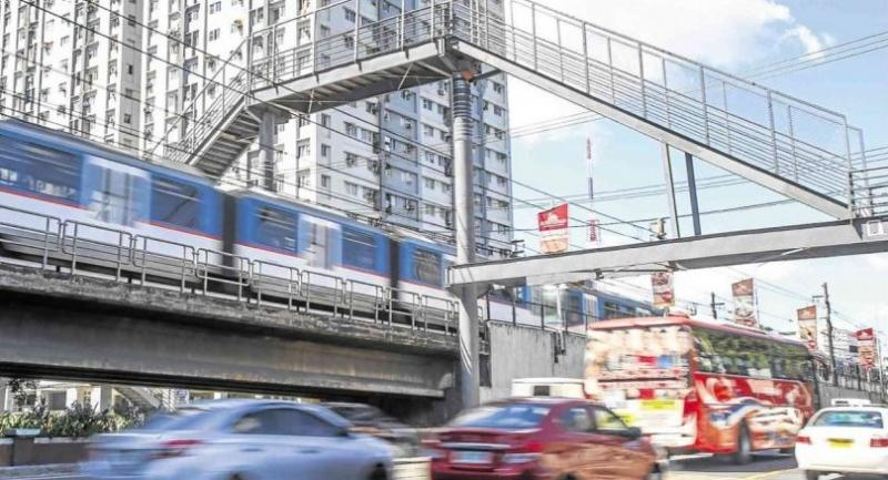 A footbridge rising on Edsa-Kamuning has been met mostly with criticisms, mainly because of its height.//JAM STA ROSA