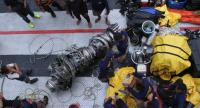Parts of an engine of the ill-fated Lion Air flight JT 610 are recovered from the sea during search operations in the Java Sea, north of Karawang on November 3.//AFP