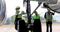Airport officials inspect the ram air turbine of an aircraft at I Gusti Ngurah Rai International Airport in Bali on Sunday.