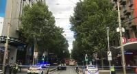 Police respond to an incident at the intersection of Bourke Street and Swanston Street in Melbourne, Australia on November 9.//EPA-EFE