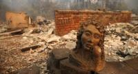 A statue remains in front of a home that was destroyed by the Camp Fire on November 10, 2018 in Paradise, California. //AFP