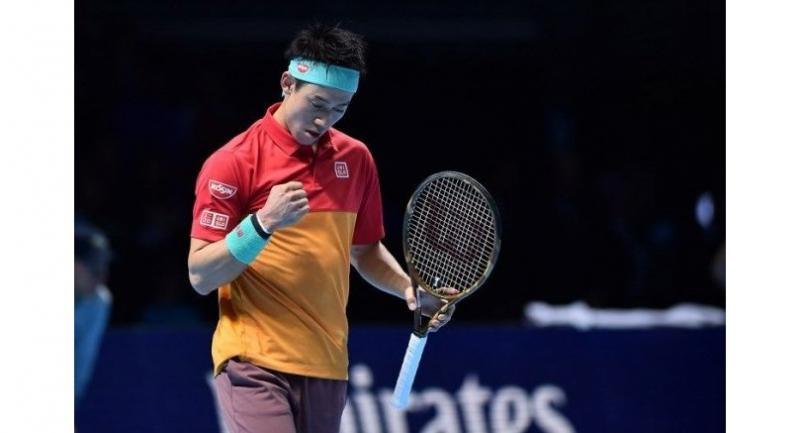 Japan's Kei Nishikori celebrates after beating Switzerland's Roger Federer 7-6, 6-3 after their singles round robin match on day one of the ATP World Tour Finals .