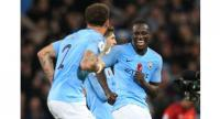 Manchester City's English defender Kyle Walker (L) and Manchester City's French defender Benjamin Mendy celebrate after winning the English Premier League football match.