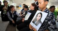 Relatives of a 38-year-old woman, who succumbed to her injuries after her husband splashed acid on her on Friday, talk to reporters yesterday.