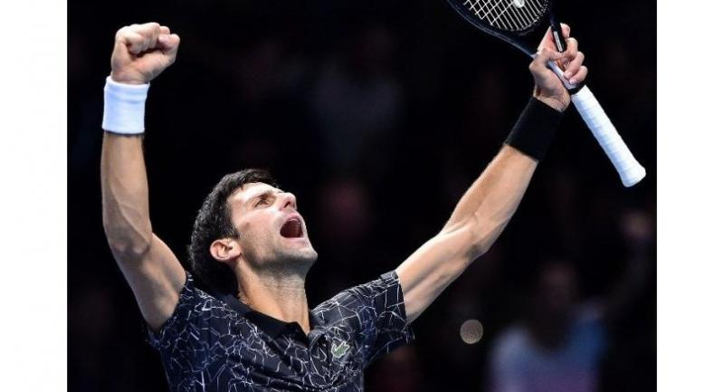 Serbia's Novak Djokovic celebrates after winning against US player John Isner during their men's singles round-robin match on day two of the ATP World Tour Finals.