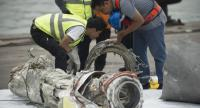 Investigators examine engine parts from the ill-fated Lion Air flight JT 610 at a port in Jakarta on November 7, 2018, after they were recovered from the bottom of the Java sea./AFP