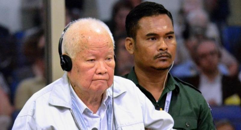 This handout photo taken and released by the Extraordinary Chambers in the Courts of Cambodia (ECCC) on November 16, 2018 shows former Khmer Rouge leader head of state Khieu Samphan stands during his verdict in court at the ECCC in Phnom Penh./AFP