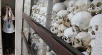 A tourist photographs of the remains of victims who died during the Khmer Rouge regime at the Choeung Ek Genocidal Center, on the outskirts of Phnom Penh, Cambodia on November 15.//EPA-EFE
