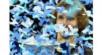 Germany's Alexander Zverev is covered in ticker tape after being presented with the trophy after beating Serbia's Novak Djokovic in their men's singles final match on day eight of the ATP World Tour Finals tennis tournament at the O2 Arena in London.