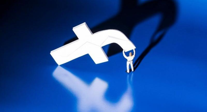 In this file photo taken on May 16, 2018 a figurine carrying the logo of social network Facebook is viewed in Paris./AFP
