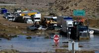 In this file photo taken on October 16, 2015, vehicles are stuck on a road after being trapped by a mudslide on California Highway 58 in Mojave after torrential rains swamped the area and forced drivers and passengers to flee on foot./AFP