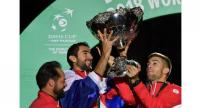 Croatia's Marin Cilis (C) holds the Davis Cup as Croatia's players celebrate their victory over France after the Davis Cup World Group final at The Pierre Mauroy Stadium in Villeneuve-d'Ascq, northern France, on November 25, 2018.