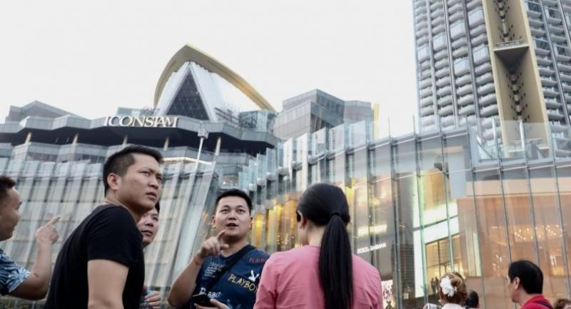 Chinese tourists explore the newly opened mega-shopping mall Iconsiam. Nation/Anan Chantarasoot