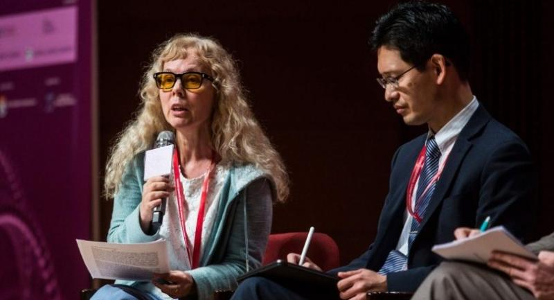 This picture taken on November 27, 2018 shows Margaret Sleeboom-Faulkner from the University of Sussex (L) speaking at the Second International Summit on Human Genome Editing in Hong Kong. /AFP
