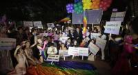 PARTY forrights An LGBTQI group yesterday marks the 10th anniversary of LGBT Day at Chamchuri Square in the capital to promote gender rights and equality in Thailand. Photo Prasert Thepsri