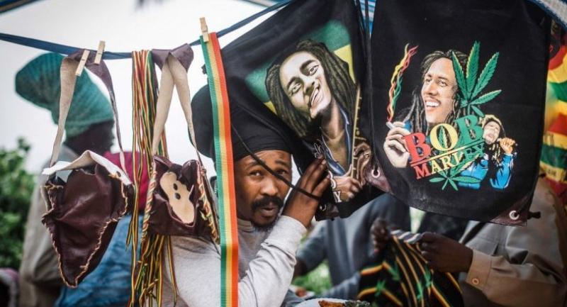 Rastafarian Reggae fans gather at the start of the Bob Marley Earthday Festival and Rasta Fair at the South Beach in Durban. /AFP