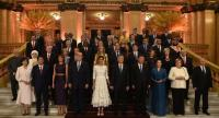This handout picture relesead by G20 Summit's Press Office shows participants of the the G20 Leader's Summit and their spouses posing for a family photo prior to a gala at the Colon Theater in Buenos Aires, on November 30, 2018./AFP