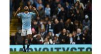 Manchester City's English midfielder Raheem Sterling celebrates scoring their second goal for 2-1 during the English Premier League football match between Manchester City and Bournemouth .