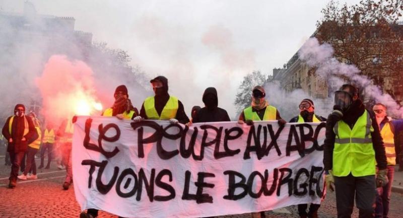 Demonstrators hold a banner reading