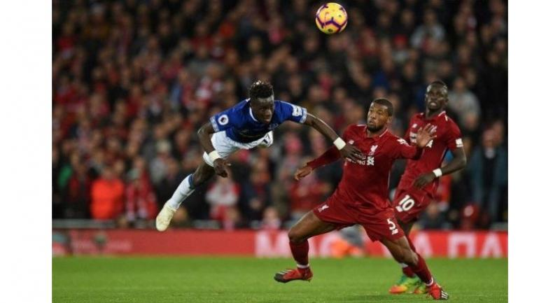 Everton's Senegalese midfielder Idrissa Gueye (L) vies with Liverpool's Dutch midfielder Georginio Wijnaldum during the English Premier League football match between Liverpool and Everton at Anfield in Liverpool, north west England.