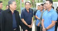 Finance Minister Apisak Tantivorawong, left, Pisit Serewiwattana, president of Exim Bank, middle, and Pira Intaratood, managing director of AIM, right, meet on Saturday at Asia Nampapa Luangprabang Co, a tap-water plant in Luang Prabang.