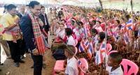 Prime Minister General Prayut Chan-o-cha greets a crowd as he leads senior officials to inspect the construction site for Lam Sapung reservoir in Chaiyaphum's Nong Bua Daeng district yesterday.