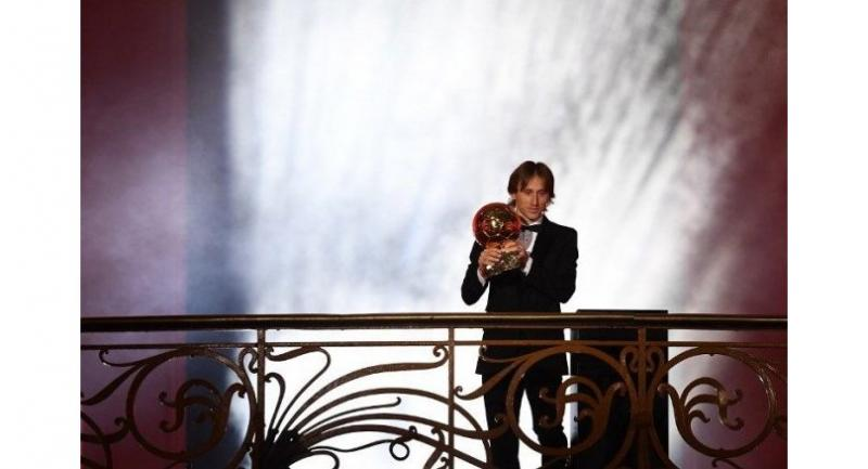 Real Madrid's Croatian midfielder Luka Modric holds the trophy after receiving the 2018 FIFA Men's Ballon d'Or award for best player of the year during the 2018 FIFA Ballon d'Or award ceremony at the Grand Palais in Paris on December 3, 2018.