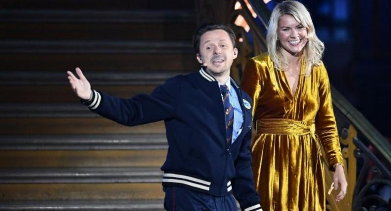 Olympique Lyonnais' Norwegian forward Ada Hegerberg (R) stands past French DJ and producer Martin Solveig gesturing after receiving the 2018 FIFA Women's Ballon d'Or award for best player of the year.//AFP