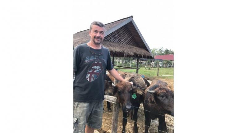 Steven McWhirter, general manager of the dairy farm and Martin's husband