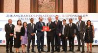 Ian Nicholls, President of GM Southeast Asia with GM executives and employees receiving the AMCHAM Corporate Social Responsibility Excellence (ACE) Recognition Gold Award from Chargé d' Affaires Peter Haymond, U.S. Embassy.