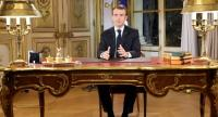 French President Emmanuel Macron speaks during a special address to the nation, his first public comments after four weeks of nationwide 'yellow vest' (gilet jaune) protests, on December 10, 2018, at the Elysee Palace, in Paris./AFP