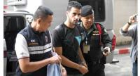 Hakeem Alaraibi (C), a former Bahrain national team footballer with refugee status in Australia, is escorted by immigration police to a court in Bangkok on December 11, 2018. // AFP PHOTO