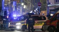 Policemen and emergency medical response vehicules are seen in the rue des Grandes Arcades in Strasbourg, eastern France, after a shooting breakout, on December 11, 2018./AFP