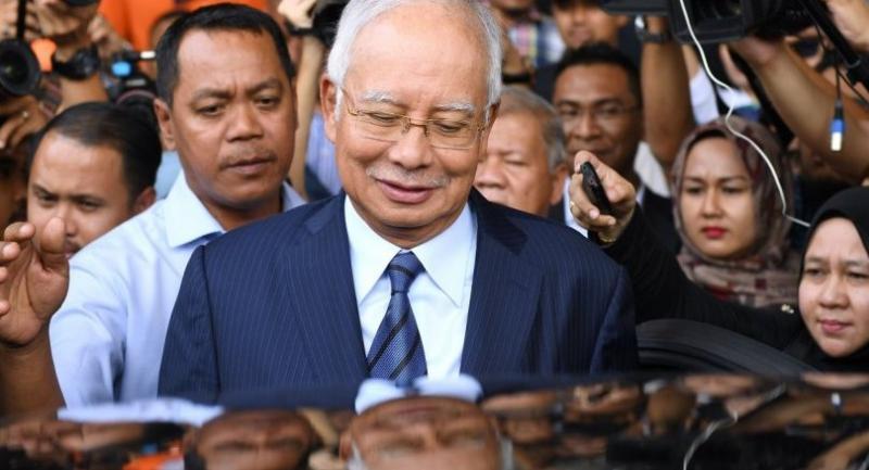 Malaysian ex-leader, former 1MDB head charged