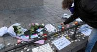 A man lights a candle in tribute to the victims of a deadly shooting the day before in central Strasbourg, on December 12.//AFP