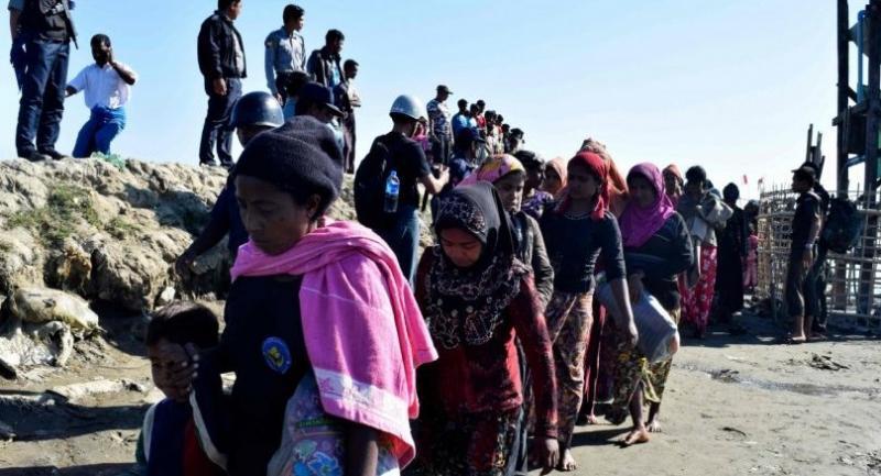 In this file photo taken on November 30, 2018 Myanmar Navy personnel escort Rohingya Muslims back to their camp in Sittwe, Rakhine state, on November 30, 2018./AFP