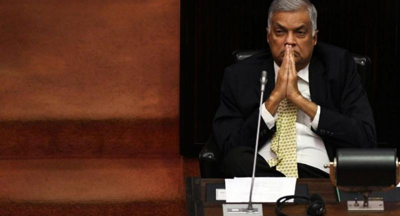 File photo : Sri Lanka's ousted prime minister Ranil Wickremesinghe gestures during a parliament session in Colombo on December 12.//AFP