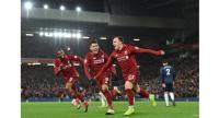Liverpool's Swiss midfielder Xherdan Shaqiri (C) celebrates with Liverpool's Dutch midfielder Georginio Wijnaldum (L) and Liverpool's Brazilian midfielder Roberto Firmino (2nd L) after scoring their third goal during the English Premier League match.