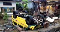 A handout photo made available by the Indonesia's national disaster management shows a ruined car that was rolled over after a tsunami hit Sunda Strait, in Anyer, Banten, Indonesia on December 23.//EPA-EFE