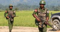 This file photo shows shows armed Myanmar army soldiers patrolling a village in Maungdaw located in Rakhine State as security operation continue following the October 9, 2016 attacks by armed militant Muslim.//AFP