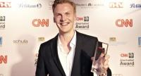German journalist Claas Relotius holds his award trophy of the CNN Journalist Award 2014, in Munich, Germany, 27 March 2014.//EPA-EFE